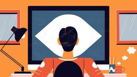 An individual sits before a computer at home, but his head's profile ominously makes the monitor resemble an eye.